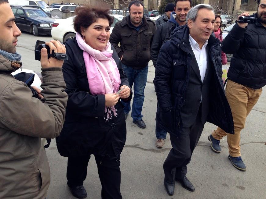 Khadija Ismayilova and her lawyer, Elton Guliyev, walkng outside en route to the offices of the Azerbaijani Prosecutor General to respond to a summons to appear. Baku, Azerbaijan.