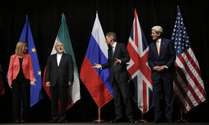 British Foreign Secretary Philip Hammond, 2nd right, U.S. Secretary of State John Kerry, right, and European Union High Representative for Foreign Affairs and Security Policy Federica Mogherini, left, talk to Iranian Foreign Minister Mohammad Javad Zarif as the wait for Russian Foreign Minister Sergey Lavrov, not pictured, for a group picture  at the Vienna International Center in Vienna, Austria, Tuesday, July 14, 2015.