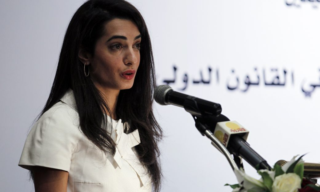 British lawyer Amal Alamuddin speaks into a microphone.