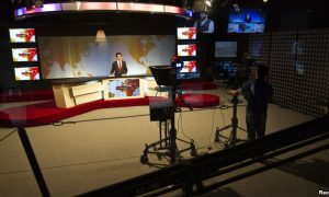 A cameraman films a news anchor at Tolo News studio in Kabul Afghanistan, October 18, 2015.