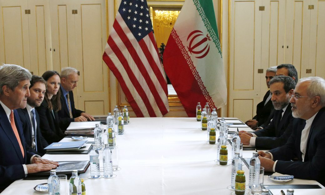 """U.S. Secretary of State John Kerry meets with Iranian Foreign Minister Mohammad Javad Zarif on what is expected to be """"implementation day,"""" the day the International Atomic Energy Agency (IAEA) verifies that Iran has met all conditions under the nuclear deal, in Vienna January 16, 2016.  (Kevin Lamarque / Reuters)"""