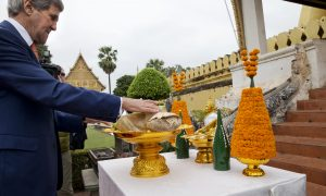 U.S. Secretary of State John Kerry places an offering of flowers during a tour of the Pha Tha Luang in Vientiane, Laos, Jan. 25, 2016. The massive gold stupa is the most important national symbol in Laos. (Jacquelyn Martin / AP)