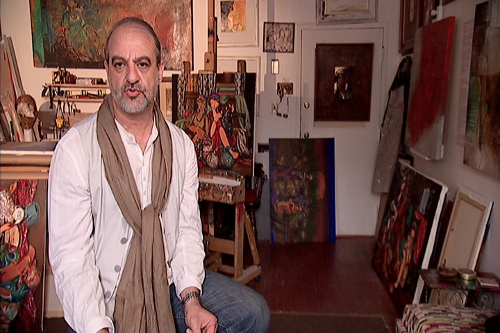 Portrait of an Iraqi painter surrounded by paintings