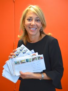 """The Director of the Office of Cuba Broadcasting, Maria """"Malule"""" González, with some of the many letters the Martís have received."""