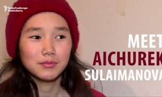 "screengrab from winning - closeup of a young girl and the title ""Meet Aichurek Sulaimanova"""