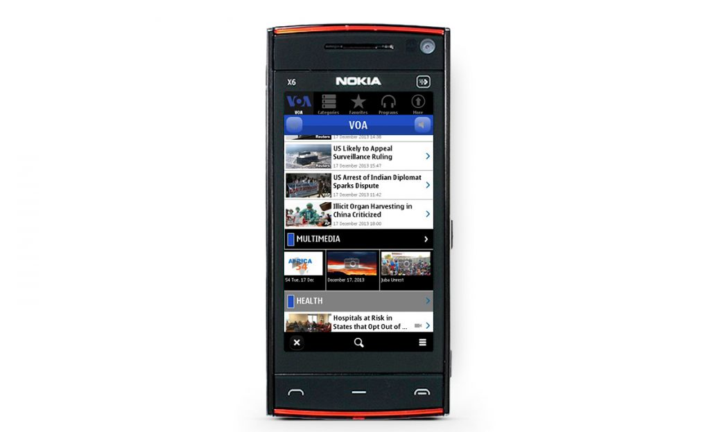 Mobile phone with a screenshot of the VOA Symbian phone app