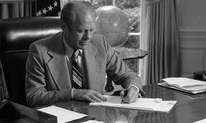 President ford signing legislation on desk