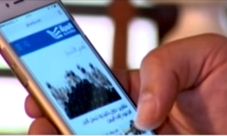 screenshot from video, shows mobile phone with Alhurra's Facebook page on the display