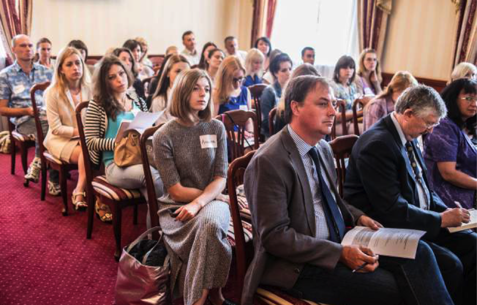 Reporters listen intently to speaker at conference