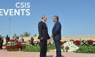 Photo of Vladimir Putin and Islam Karimov speaking outdoors