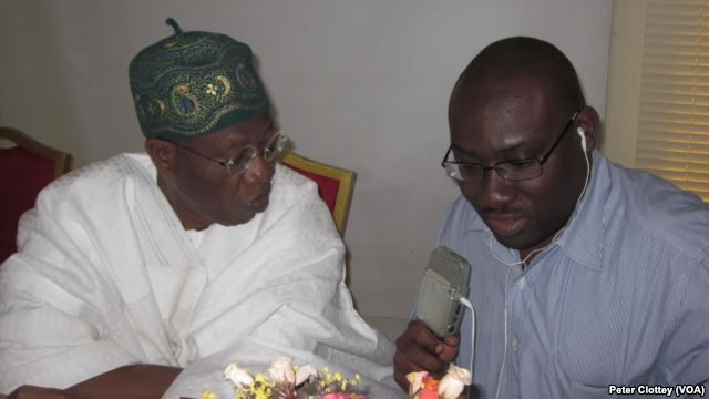 Alhaji Lai Mohammed, spokesman for the All Progressives Congress (L), with VOA English to Africa reporter Peter Clottey