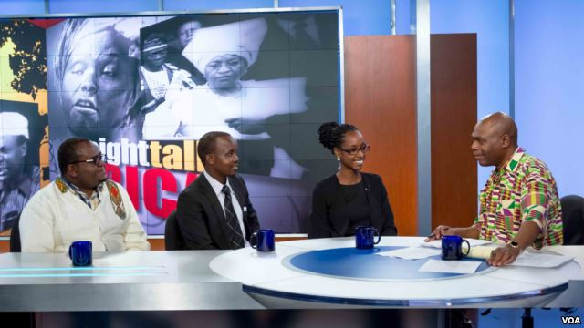 Three people sit at an anchor desk, speaking with the anchor of a tv show