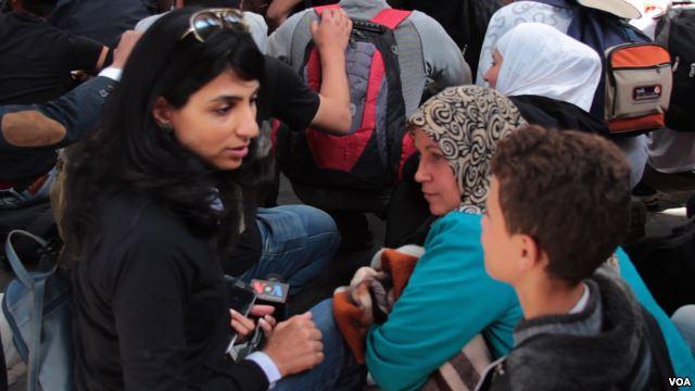 VOA correspondent Ayesha Tanzeem speaks to refugees in Hungary
