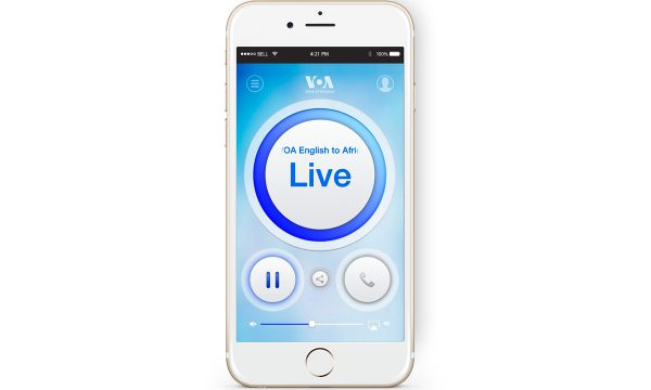 A mobile photo with a screenshot of the VOA mobile streamer app