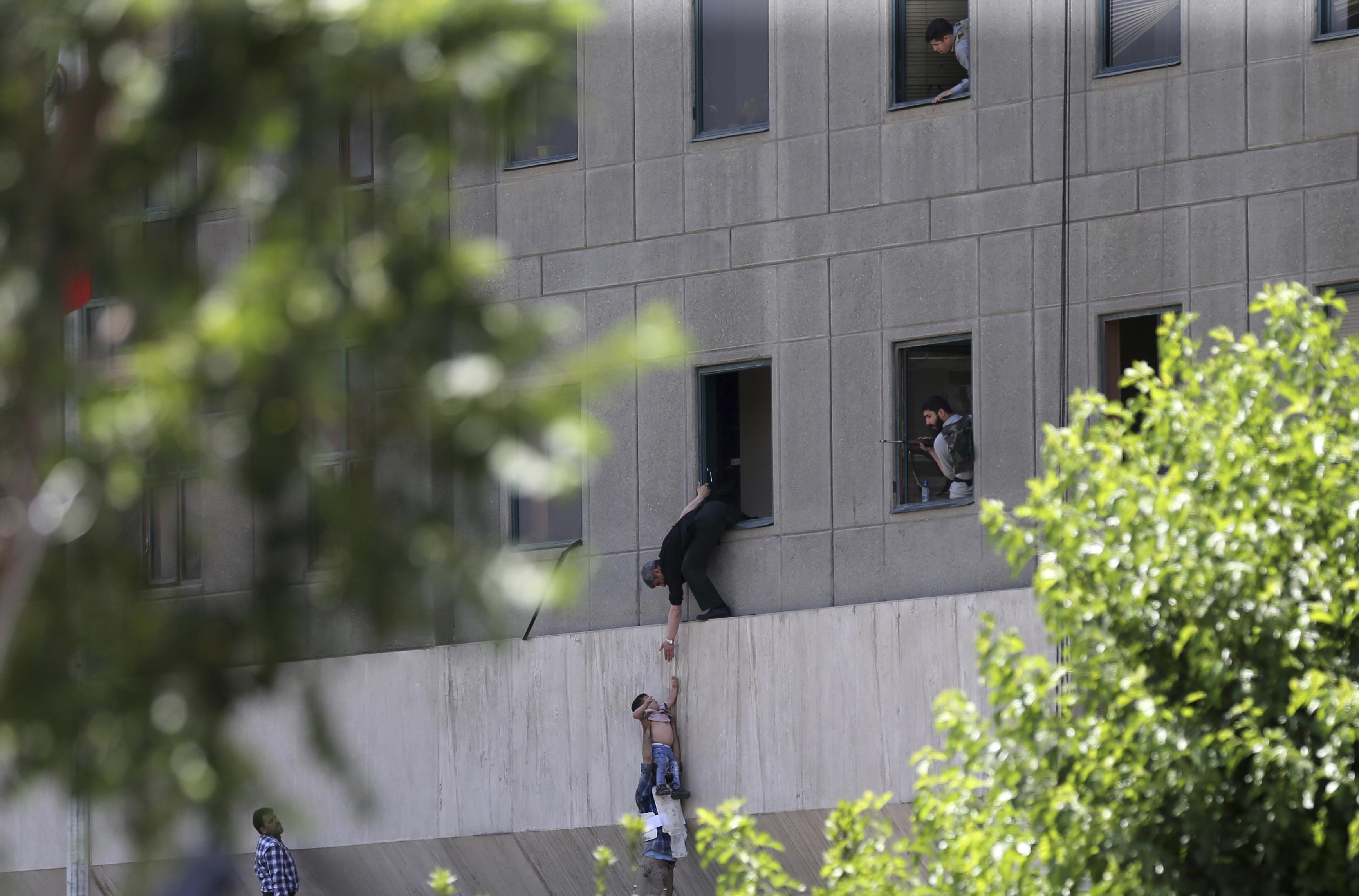 Iran's parliament, Khomeini Shrine attacked