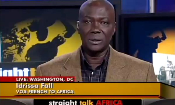 A dark-skinned man in a television studio