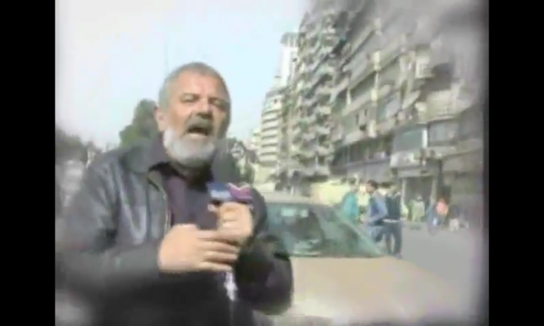 man reporting on the street