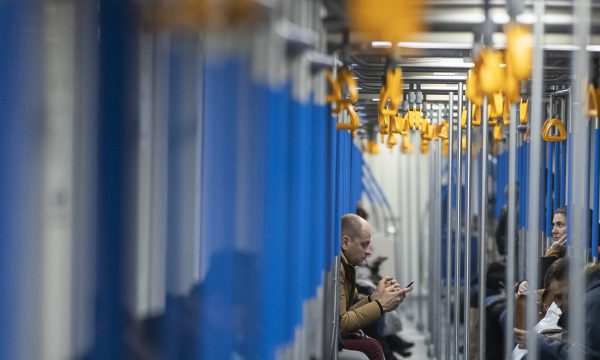 A man uses his smartphone in a subway train in Moscow