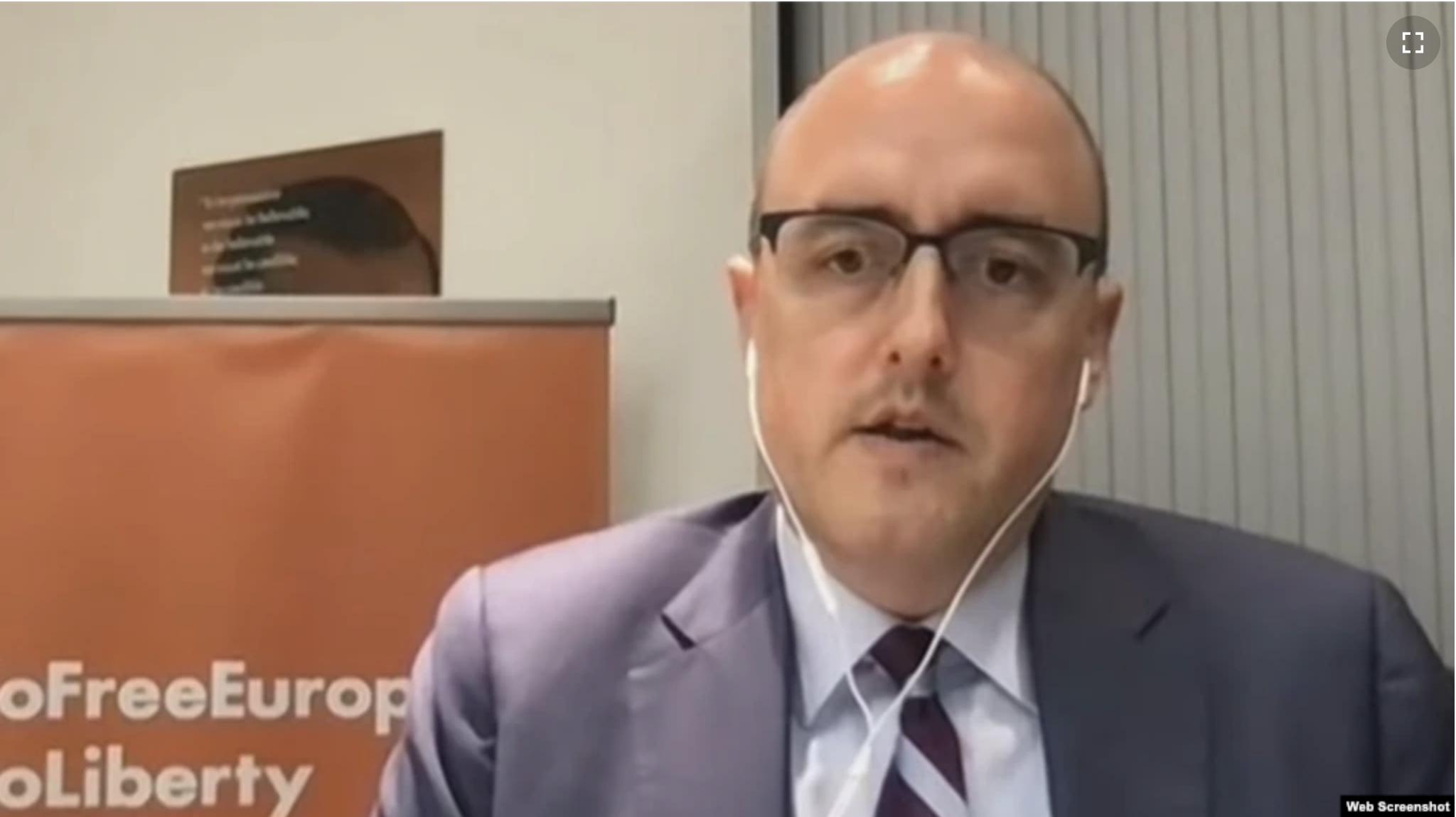 man with glasses wearing headphones